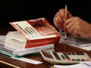 Начисление налогов при погашении долга имуществом